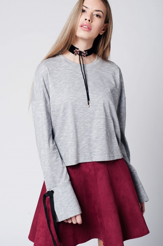 Grey top with bell sleeves and tie detail
