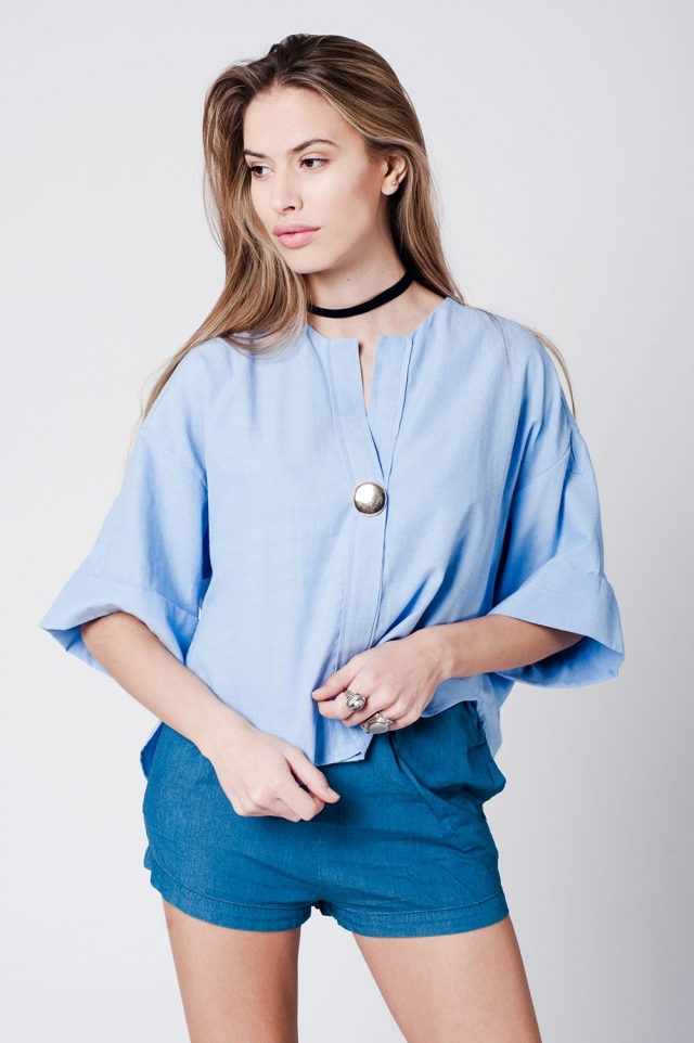 Blue cotton top with brooch