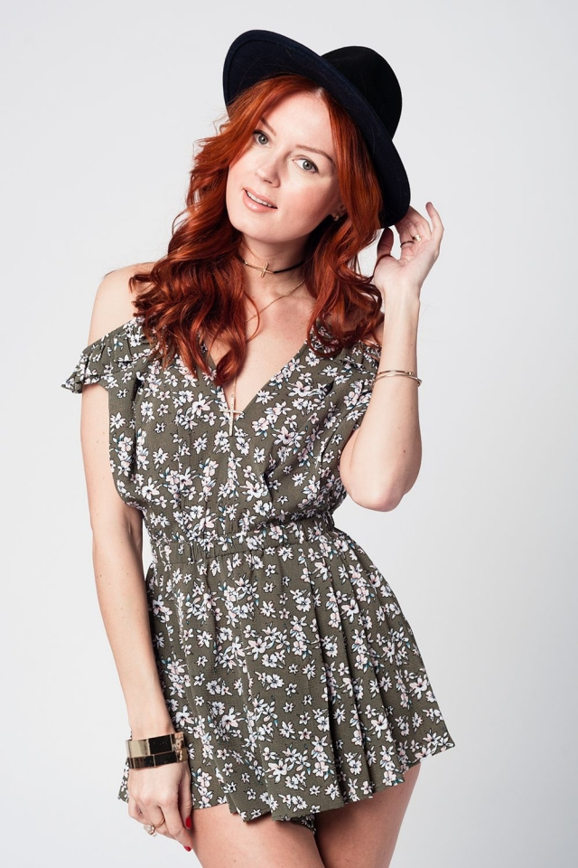 Greem romper with floral print and ruffle detail