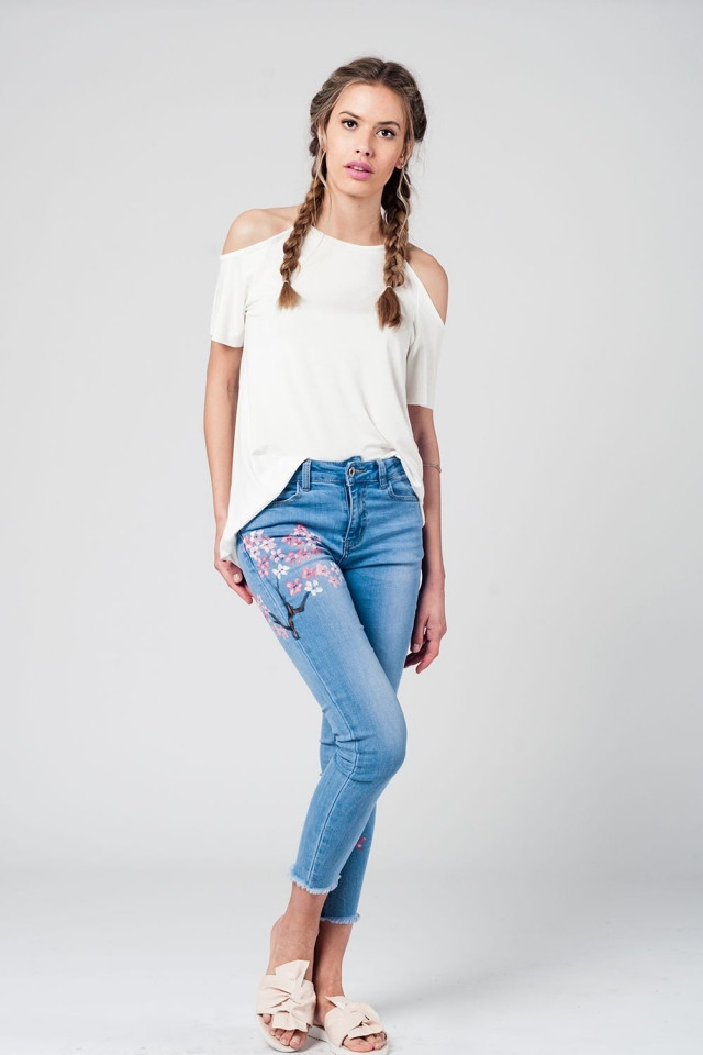 Mid wash jeans with painted flowers