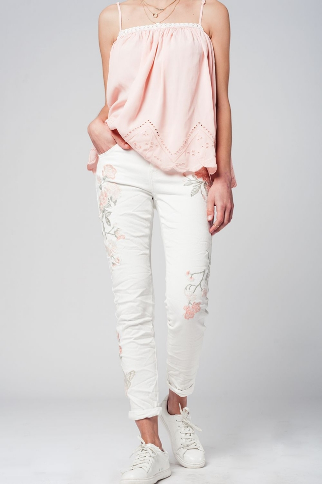 White jeans with embroidered flowers