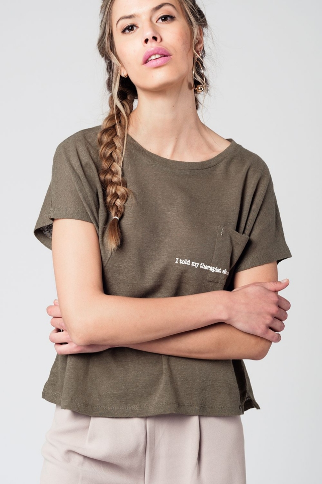 92eb389800fa Khaki t-shirt with text and pocket at the front