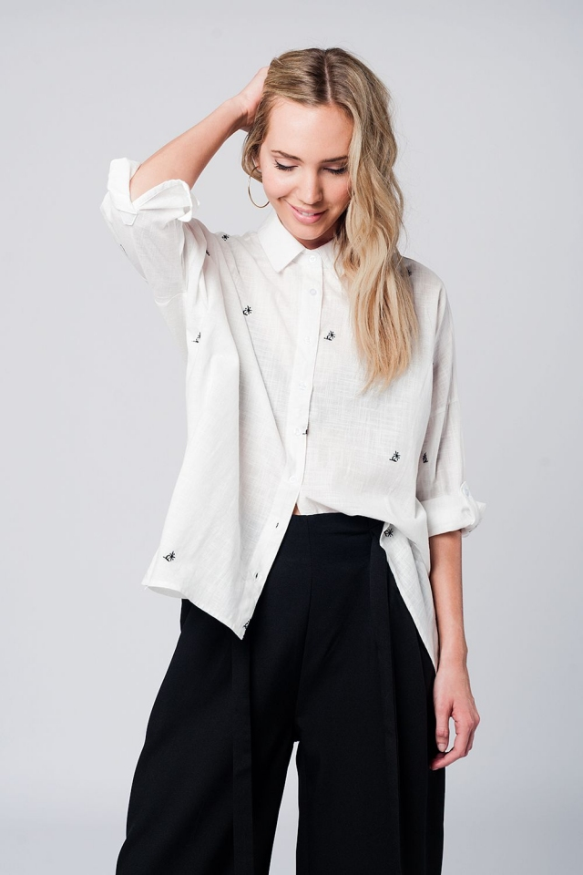 White oversized shirt with embroidered details