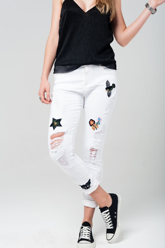 White jeans with embroidered details