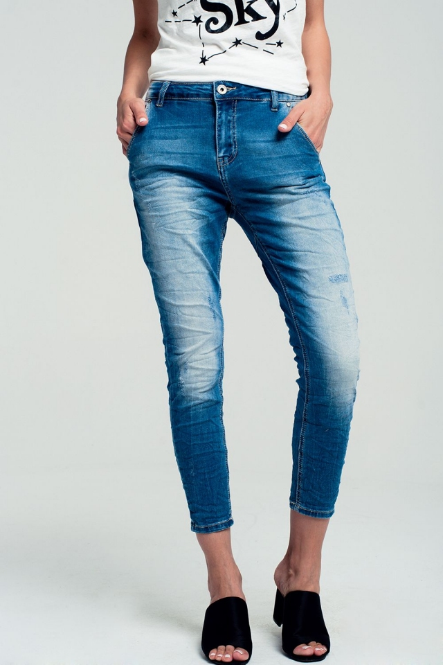 Medium blue wash stretch jeans with abrasion detail