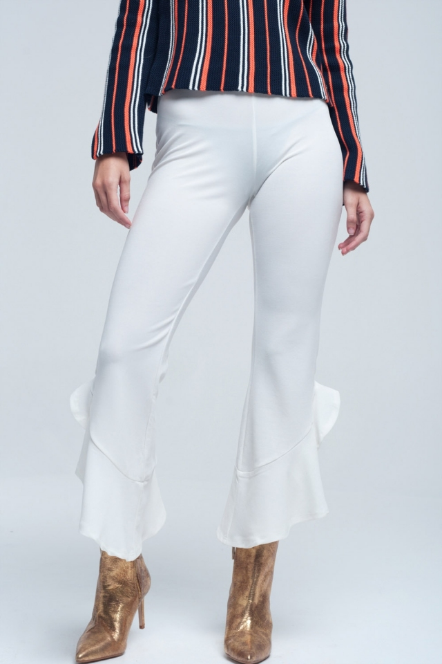 Midi cream pants with ruffles on the bottom