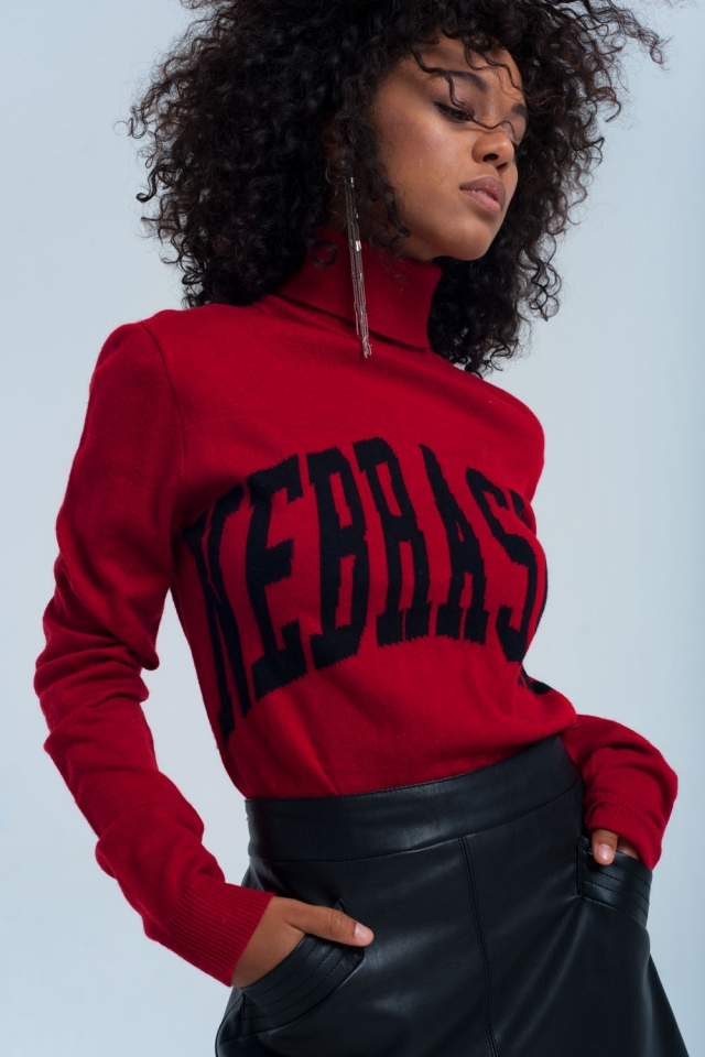 Red turtleneck sweater printed text