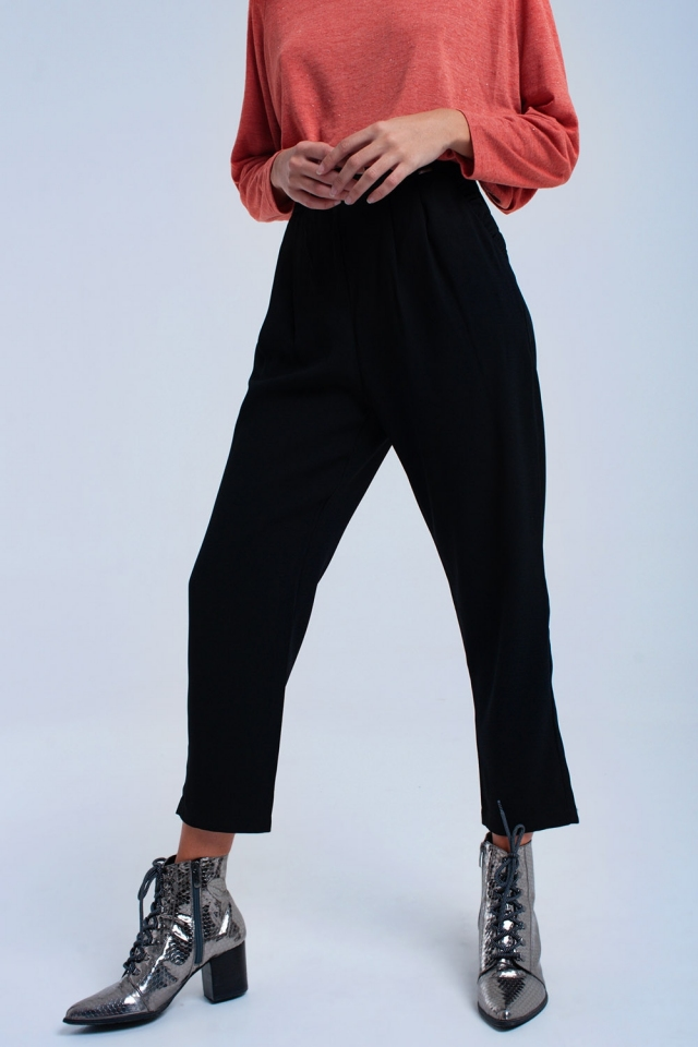 Black pants with ruffles and laces