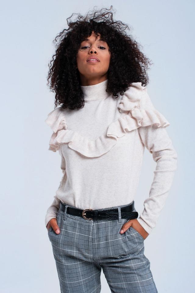Beige sweater with ruffle