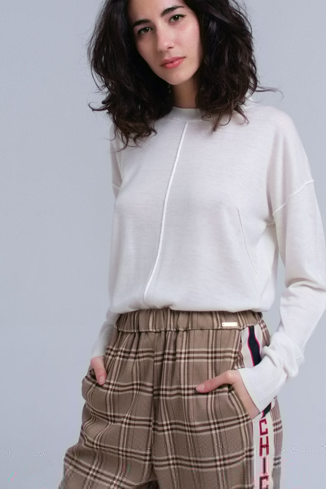 Asymmetric sweater in cream