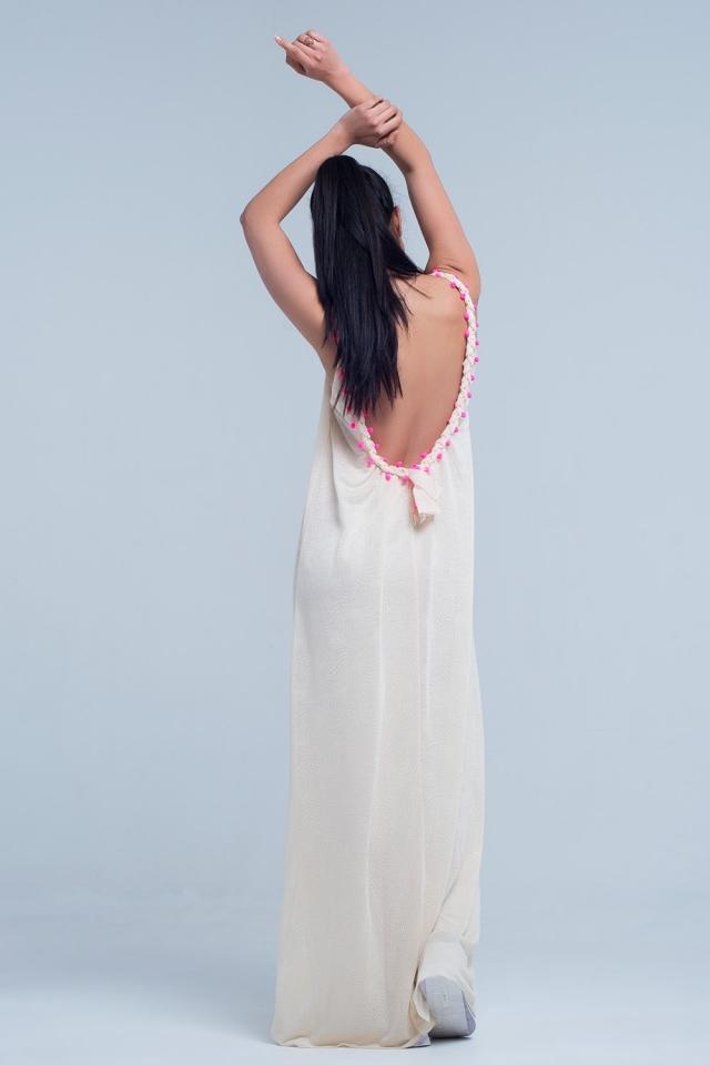 Beige maxi dress with with pom pom detailing