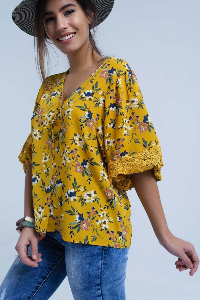 Yellow blouse with floral print