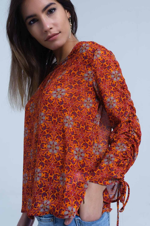Red blouse with floral print