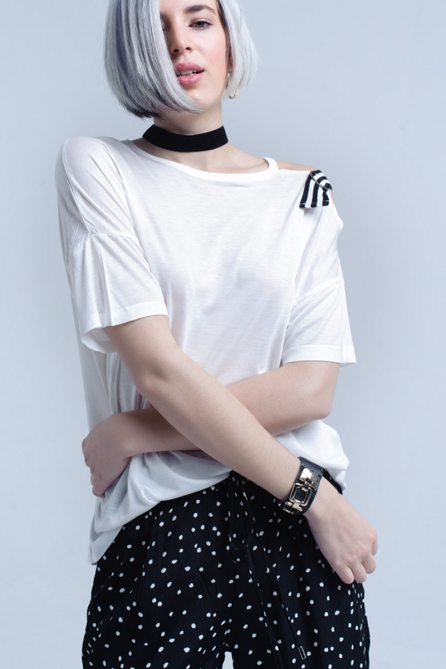 White t-shirt with one open shoulder