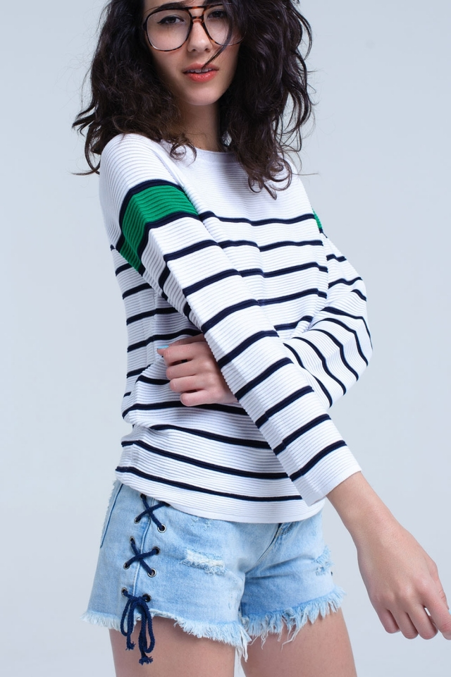 White sweater with stripes and green detail in sleeves
