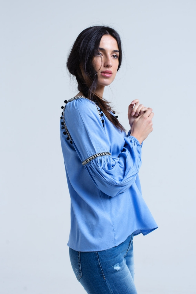 Blue shirt with tassels and embroidered details