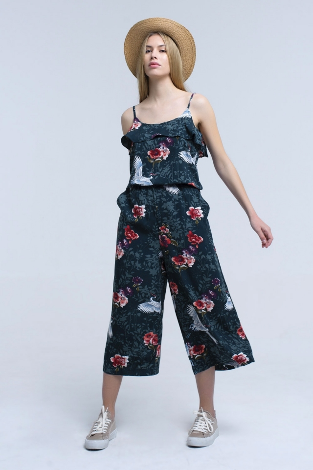 Green jumpsuit with flowers and leaves