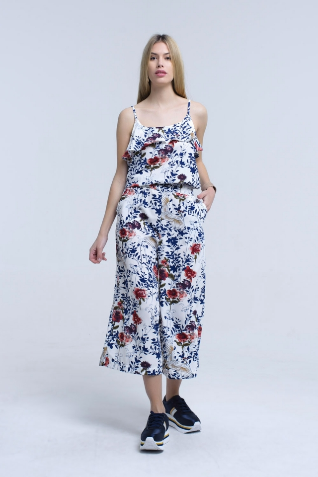 white jumpsuit with flowers and leaves