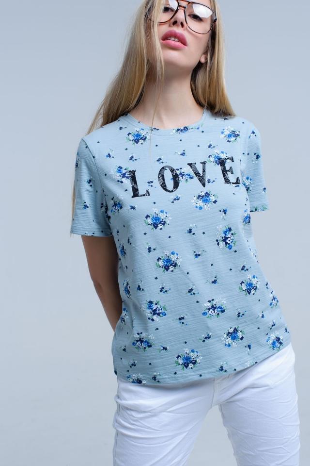 Blaues T-Shirt mit Blumendruck und Logo
