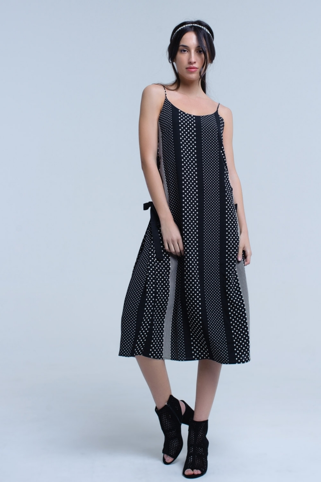 Black dress with polka dots and side loop detail