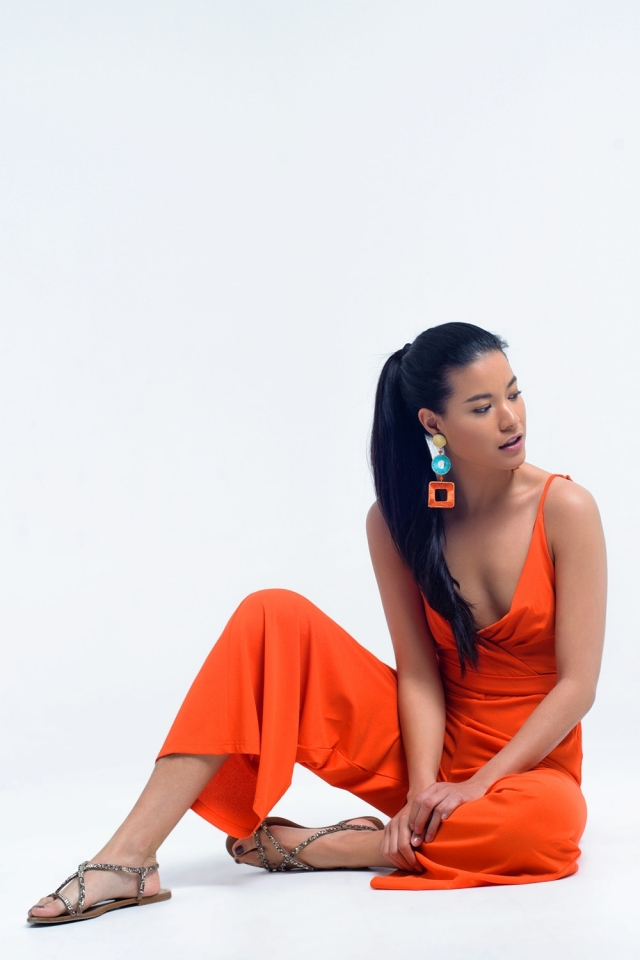 orange jumpsuit with crossed neckline