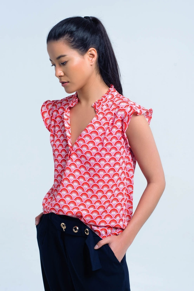 Red top with geo print and ruffled detail