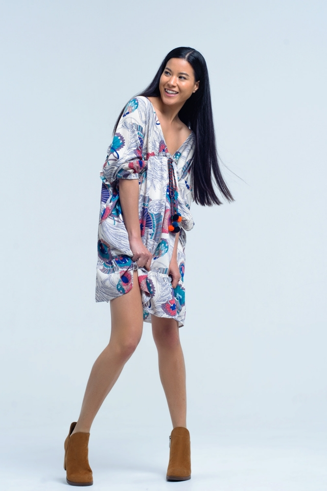 Beig dress with printed flowers and ruffles