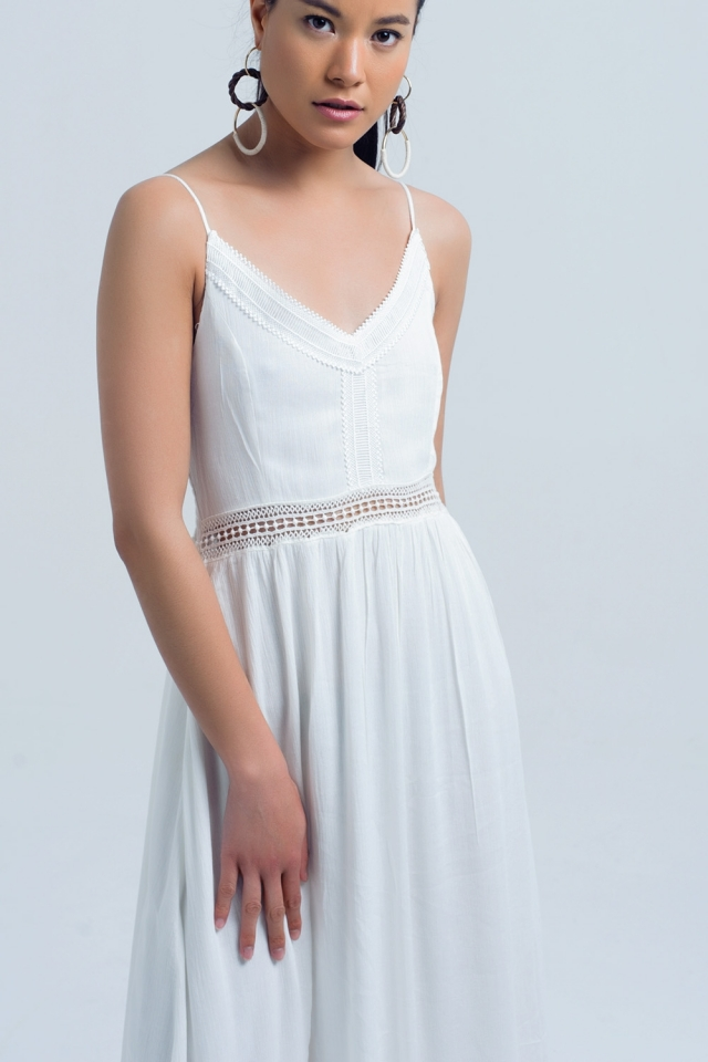 Long white dress with openwork detail at the waist