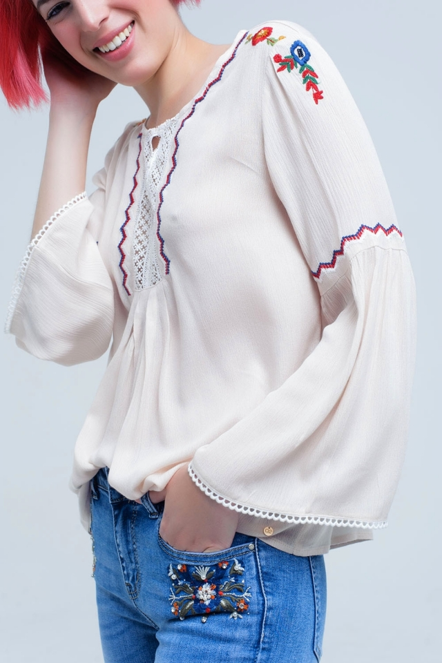 Beige top with embroidered flowers and lace