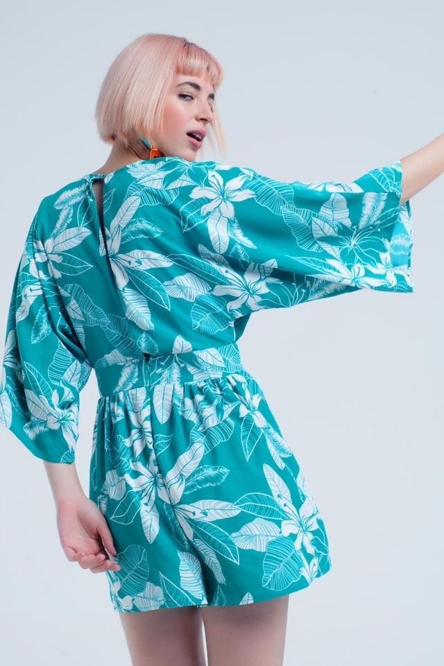 Green jumpsuit with floral pattern