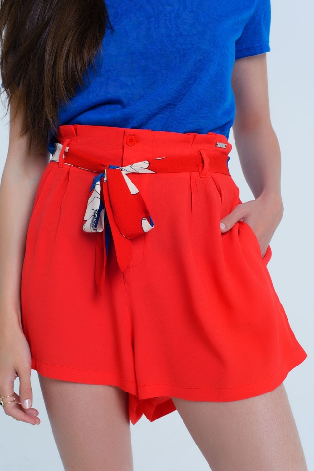 Red shorts with flower belt