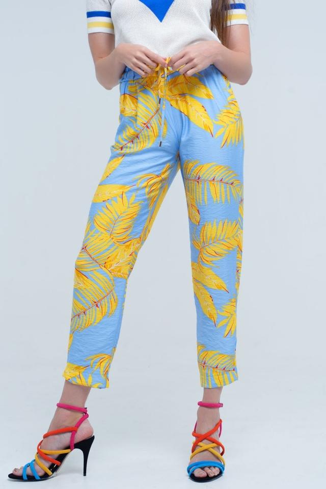 Gelbe Hose mit Blattdruck und Taschen