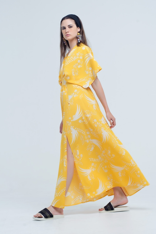 Yellow long dress with printed flowers and openings