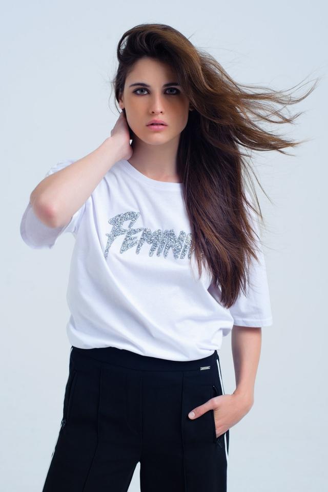 white t-shirt with bright 'feminin' logo