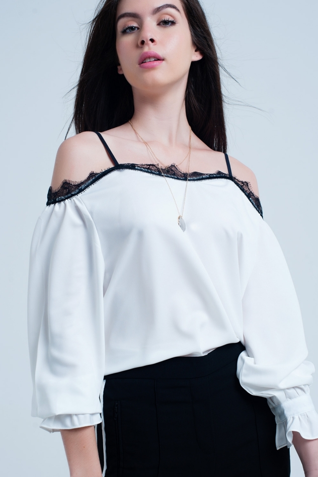 White top with black lace and bare shoulders