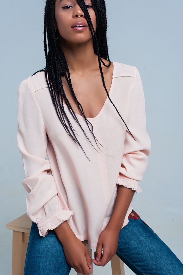 Light pink flowing blouse