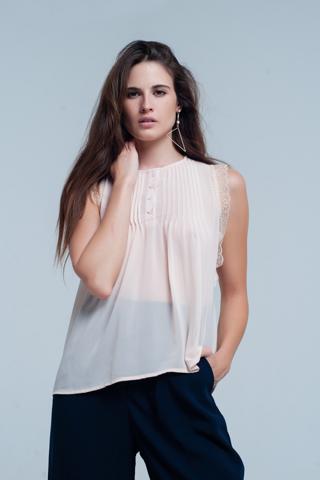 Beige sleeveless top with lace details