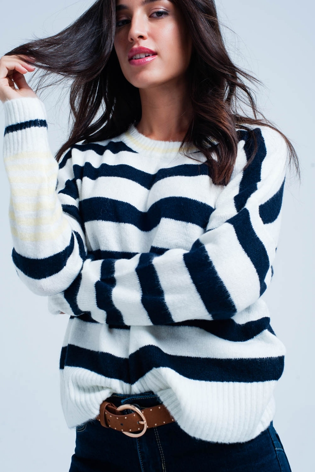 White sweater with stripes and yellow detail in sleeves