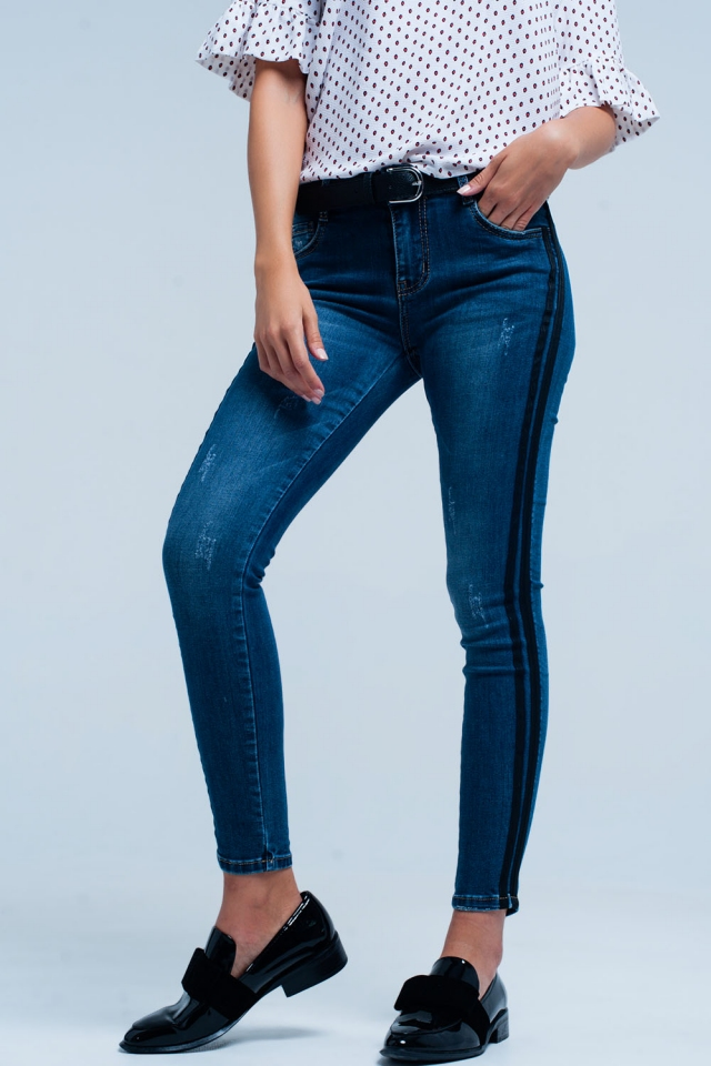 Blue skinny jeans with black side stripe