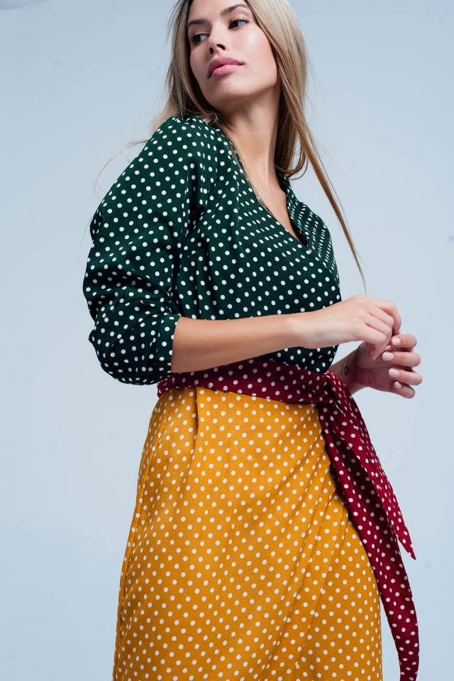 Green wrap front midi dress in polka dot print