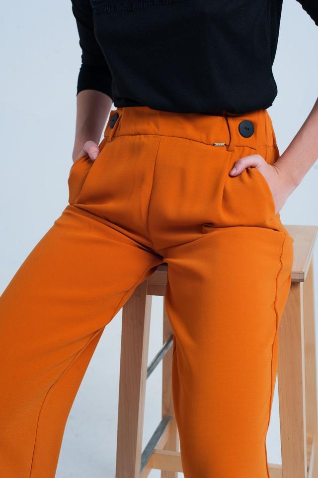 Orange Hose mit weitem Bein und Knöpfen