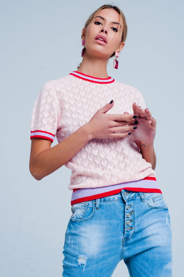 Pink open knit sweater in geo pattern