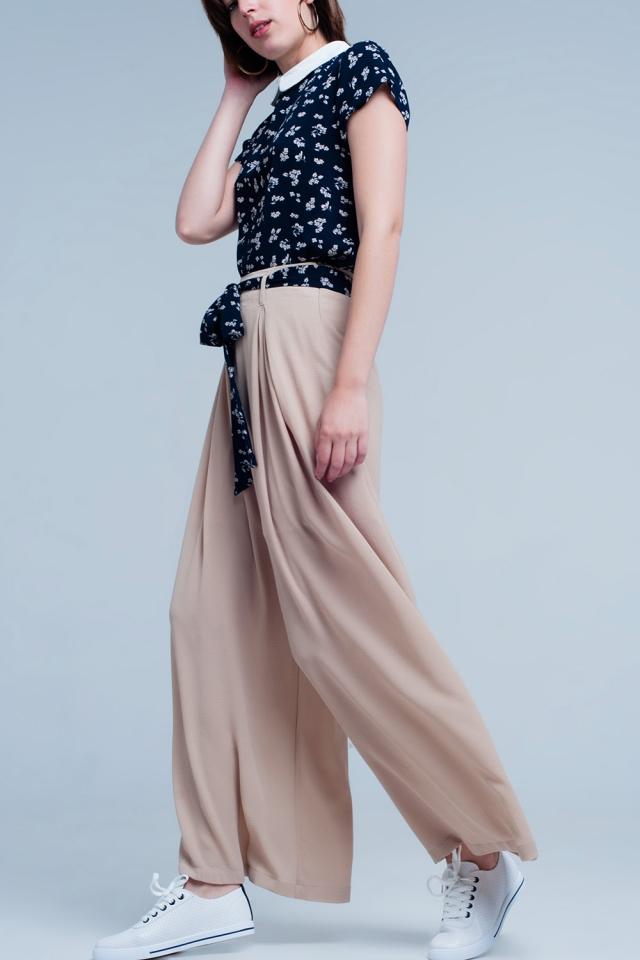 Black pants with floral beige