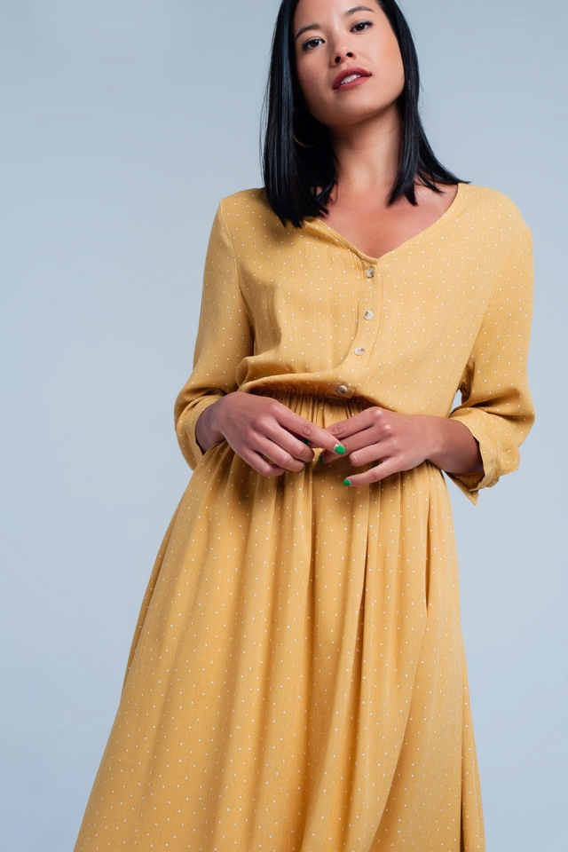 Mustard dress with v-neck and dots