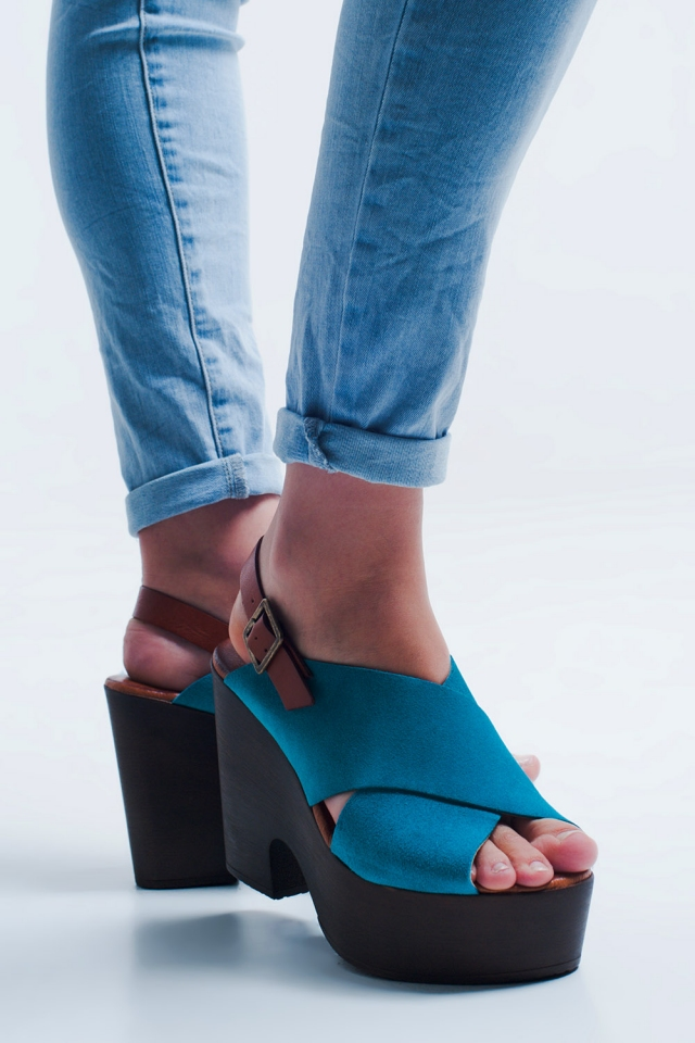 High heels with turquoise crossed straps