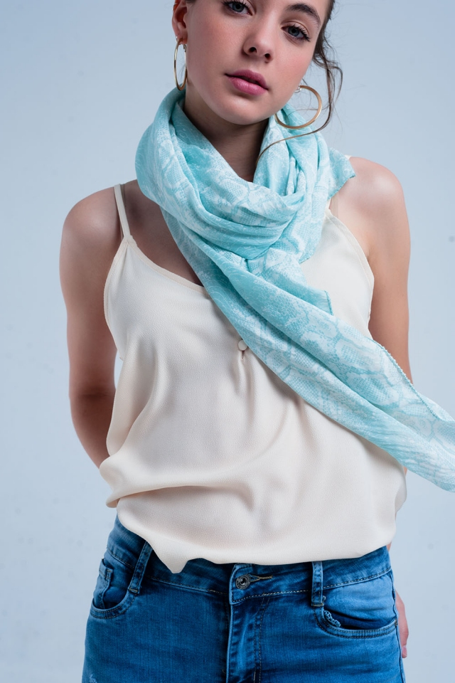 Green scarf with snake print