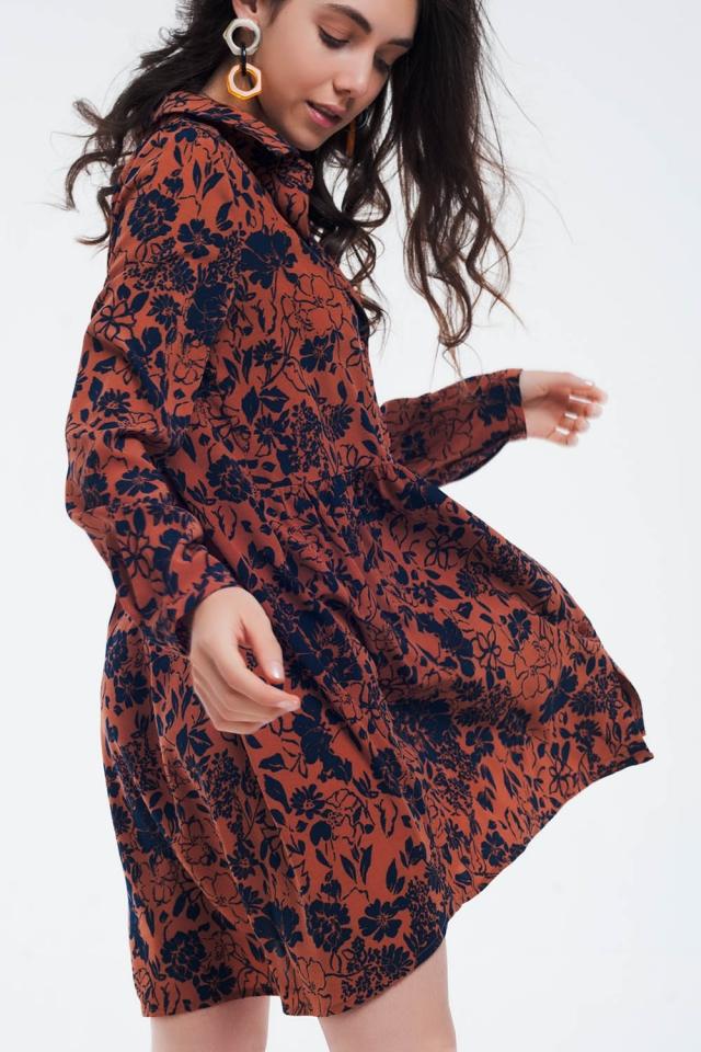 Button through dress with drop hem in orange
