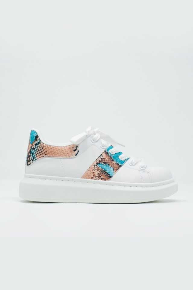 White sneakers with snake print detail
