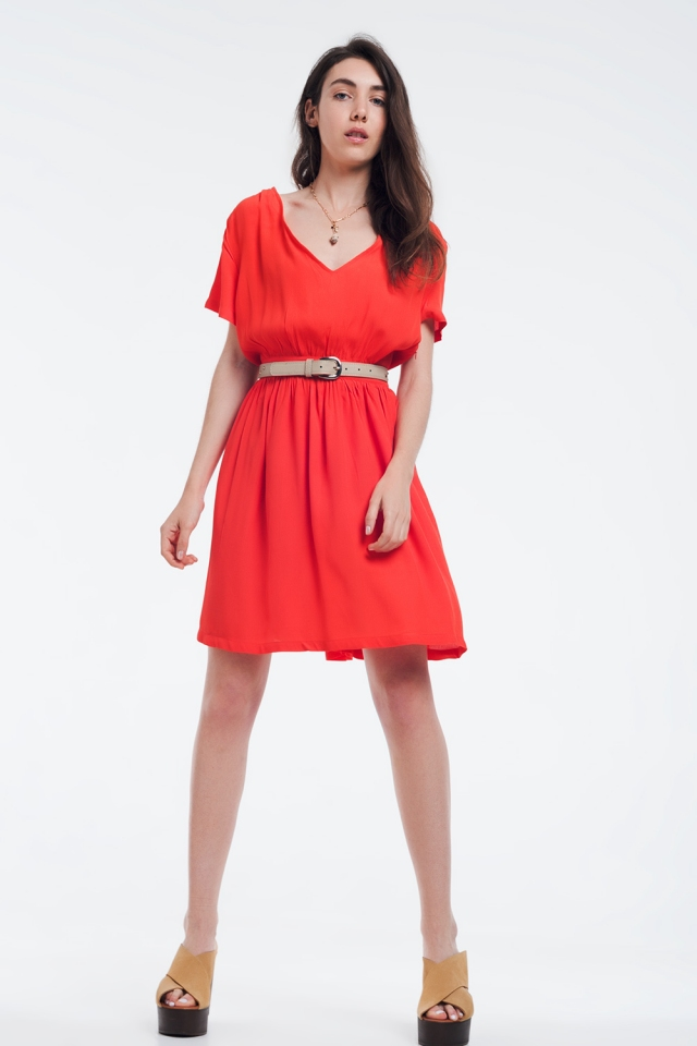 Mini orange dress with flight and detail on the shoulders