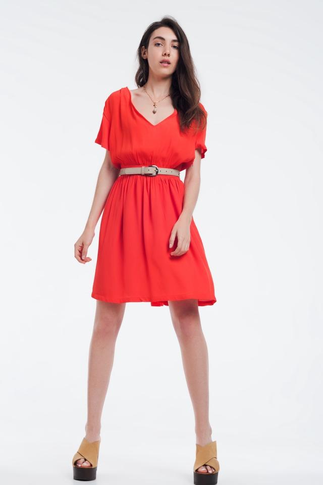 Mini orange Kleid mit Flug und Details auf den Schultern